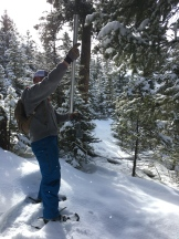 Kelsey takes a snow core