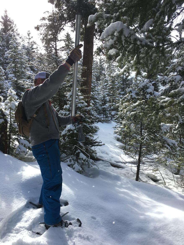 Kelsey takes a snow core
